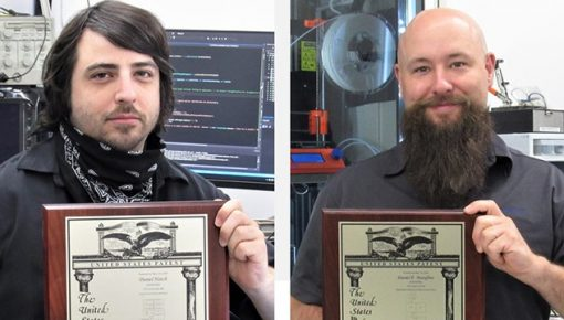 Dan Hatch, Dan Marafino proudly displaying their U.S. Patents