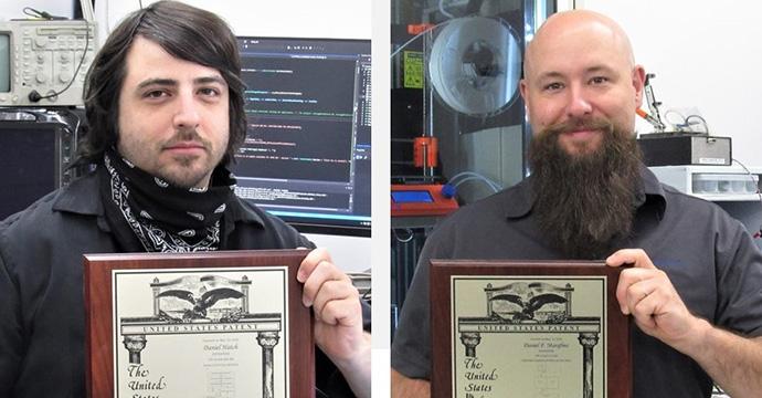 Dan Hatch, Dan Marafino proudly displaying their U.S. Patents