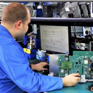 Employee performing service on automotive electronics