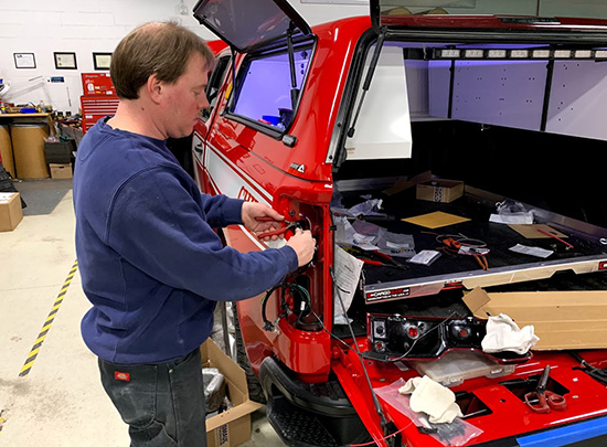 Employee servicing a vehicle